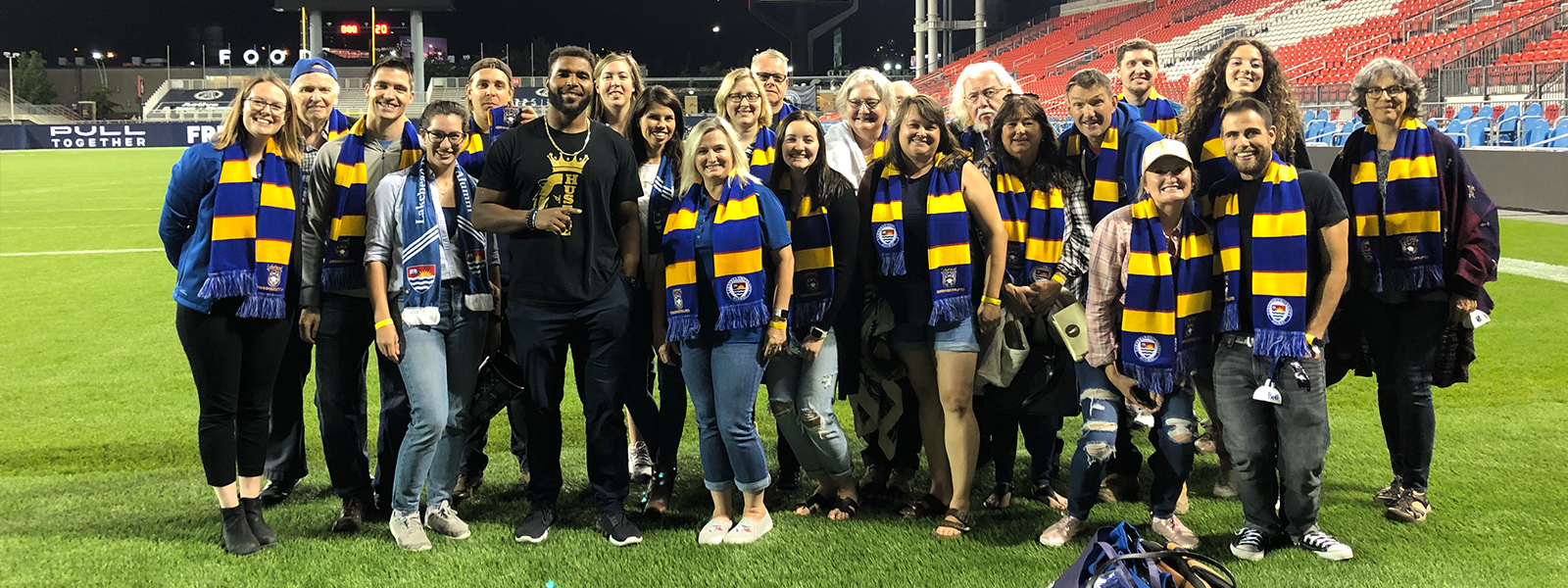 Our Toronto Area Alumni Chapter on the field for an Argos game