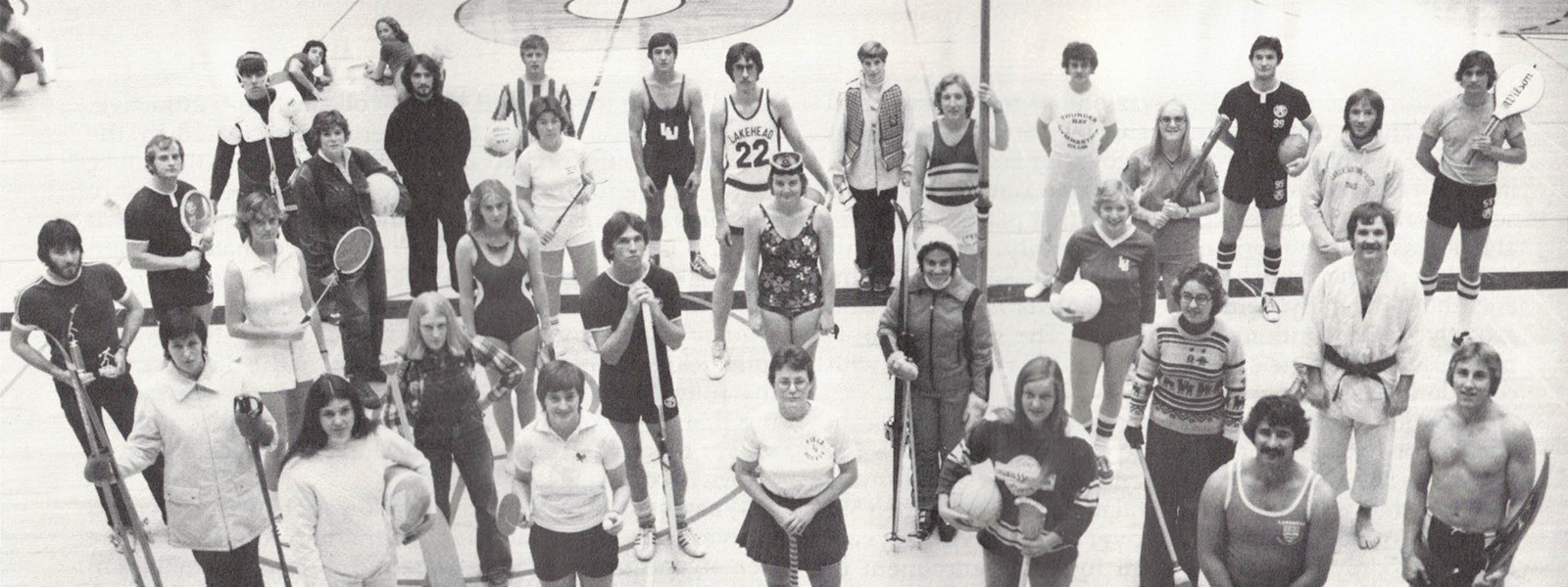 Pictured are students in the Fieldhouse representing the different sporting activities offered by the program in the 1970s.