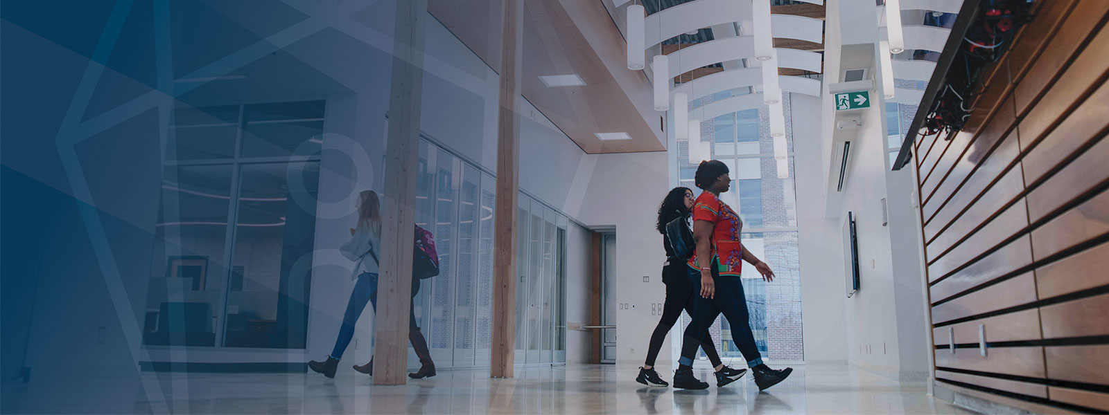 Students walking in CASES Building