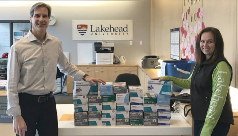 Dr. Dean Jobin-Bevans, Principal of Lakehead Orillia, and Rebecca Heffernan, Research & Strategic Initiatives Facilitator, accepted more than 4,000 pairs of gloves that went to the Orillia Soldiers' Memorial Hospital.