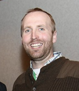 Dr. Adam Moir headshot