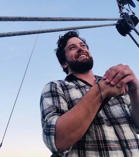 Christopher Britt on a sailboat