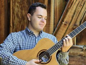 Matthew Sloan playing the guitar