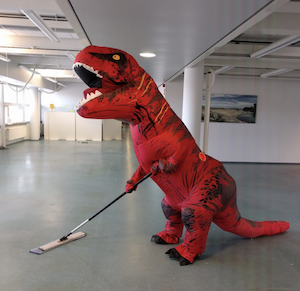 Carmen Pekkarinen dressed up as a T-Rex
