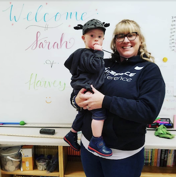Sarah and her son Harvey visit a classroom