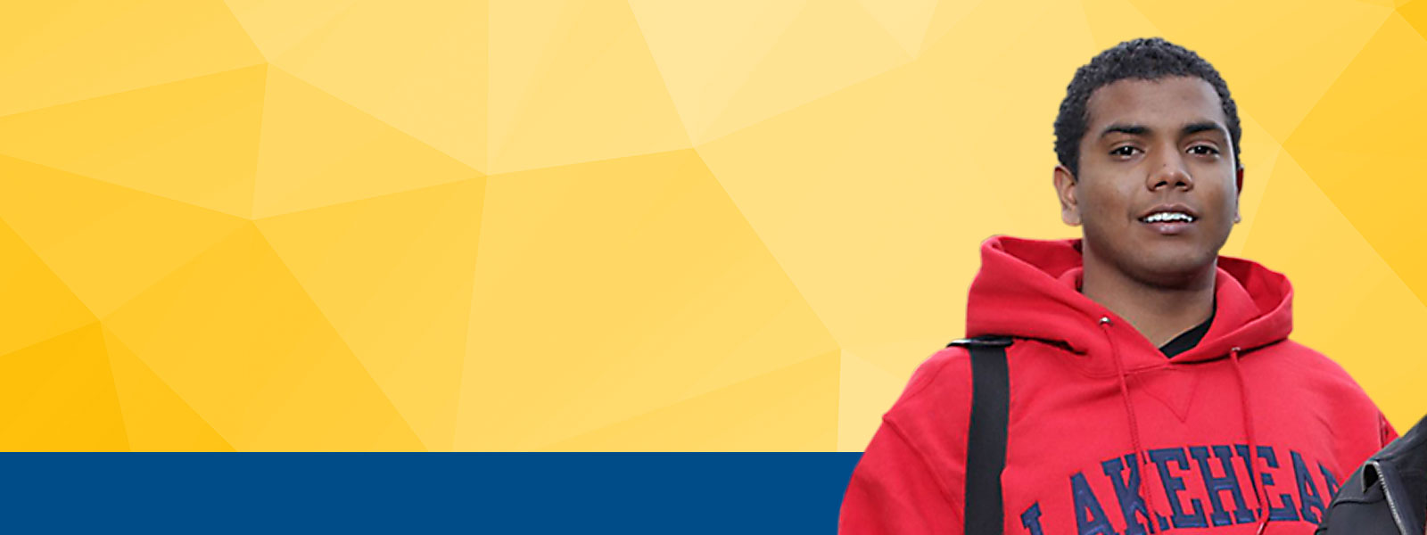 Smiling student wearing red Lakehead hoodie