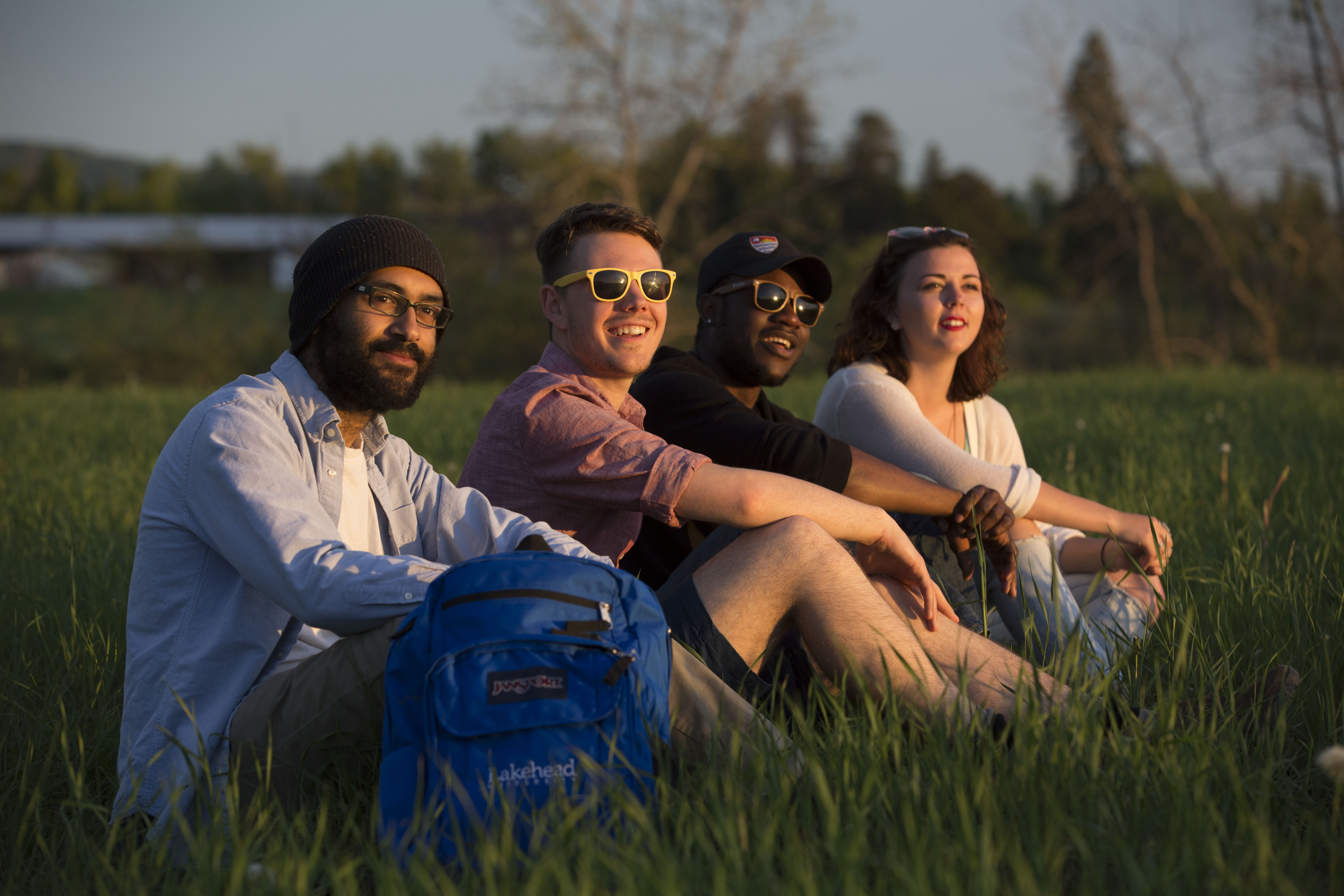 Group of International students sitting in Hillcrest Park