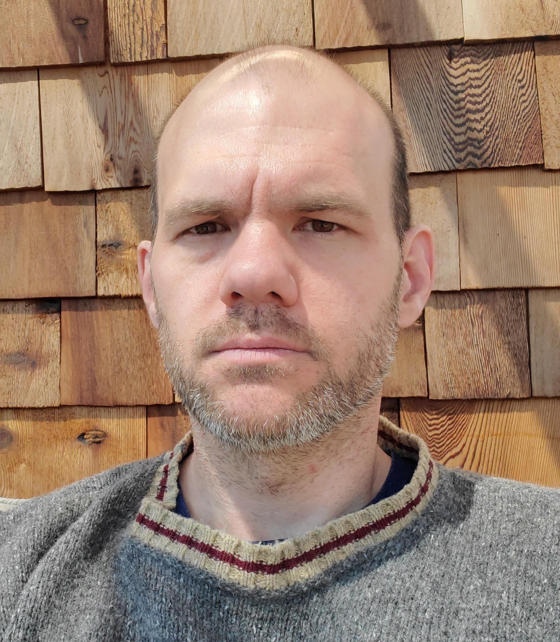 Headshot of Ian Mackay.