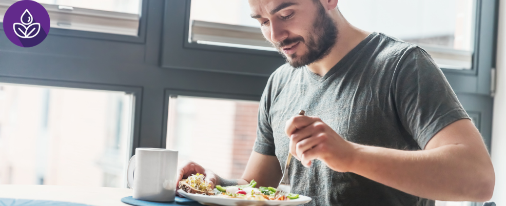 Man eating from a plate, Student Health and Wellness logo in corner