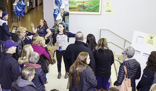 Prospective students and their families receive a tour of the Lakehead University Orillia campus.