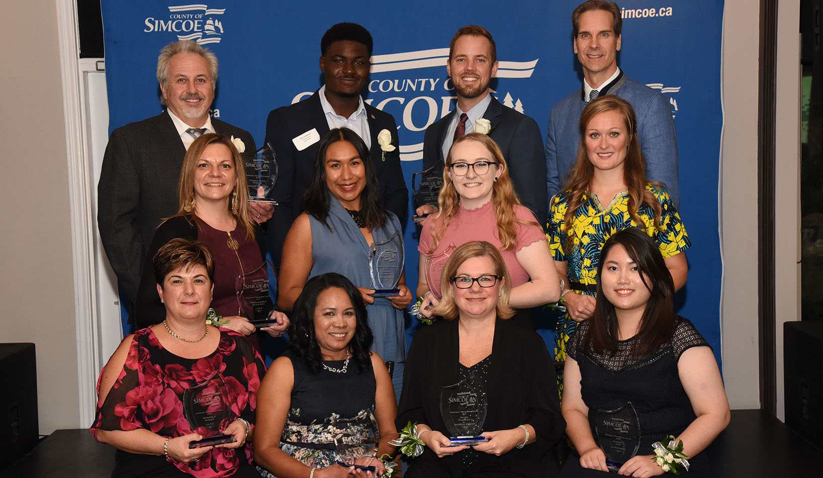 The 12 recipients of the County of Simcoe Newcomer Recognition Awards