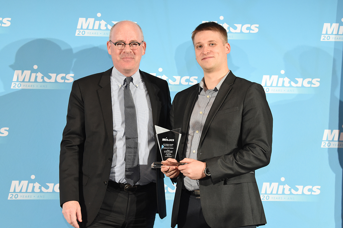 Oleksandr Bubon of Lakehead University is presented with the Mitacs NRC IRAP Award for Commercialization