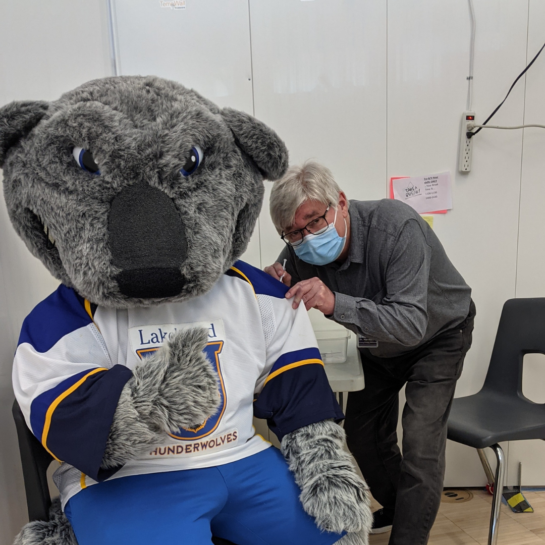 Image of wolfie receiving a COVID-19 Vaccine