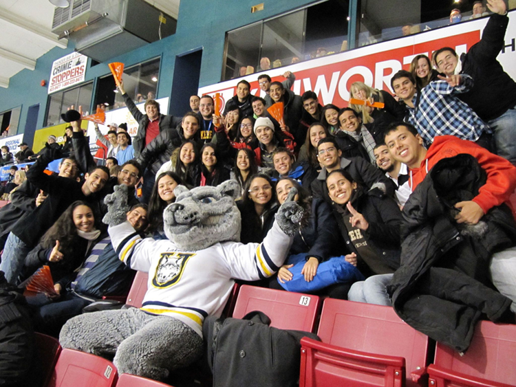 Students pose with Wolfie at the Thunderwolves Hockey Game
