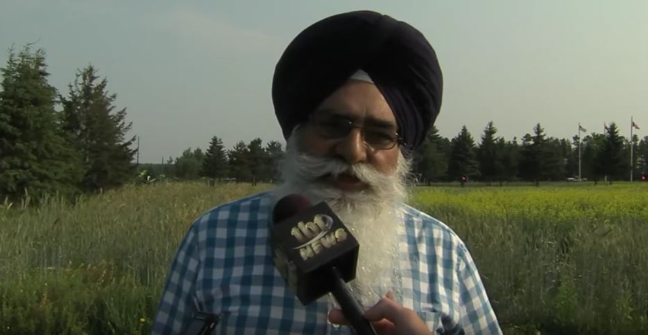 Dr. Tarlok Sahota being interviewed by tbt newswatch in one of the many fields of the agricultural research station