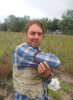 Dan Brazeau holding a Pantherophis gloydi