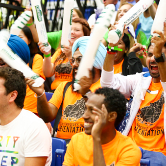 Students excitedly cheering during an orientation event