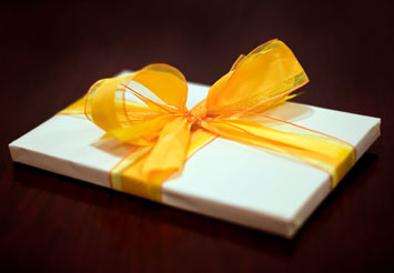 Present with yellow ribbon