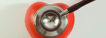 stethoscope ontop of red heart