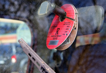Parking Pass displayed on mirror of Car