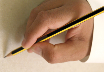Researcher holding a pencil to write