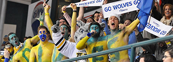 Lakehead University fans with body paint cheering at a sports outting