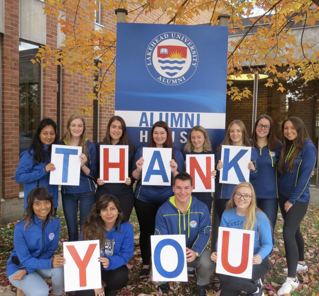 Student callers holding up a thank you sign