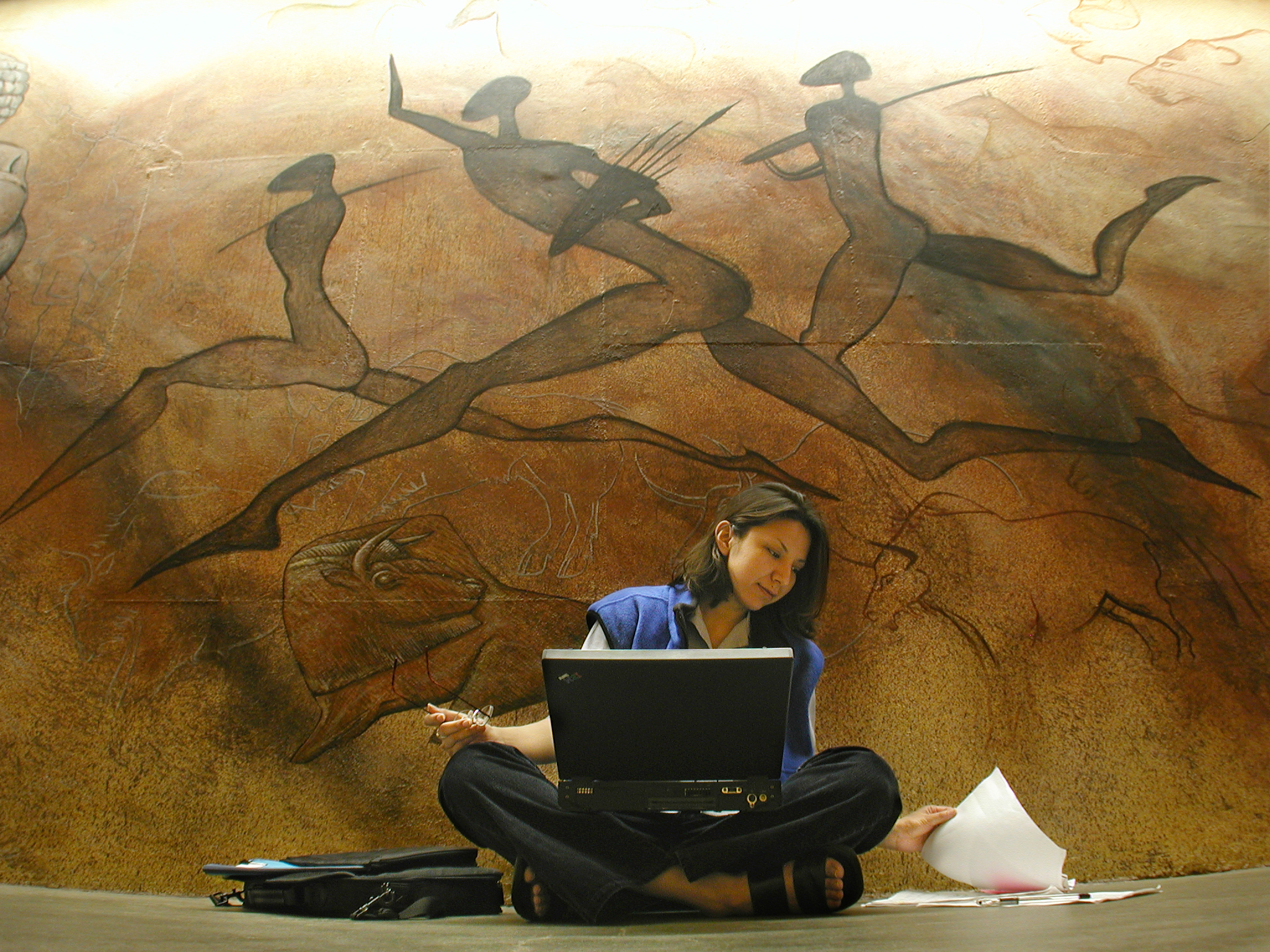 Girl sitting in tunnel, infront of beautiful Aboriginal Artwork