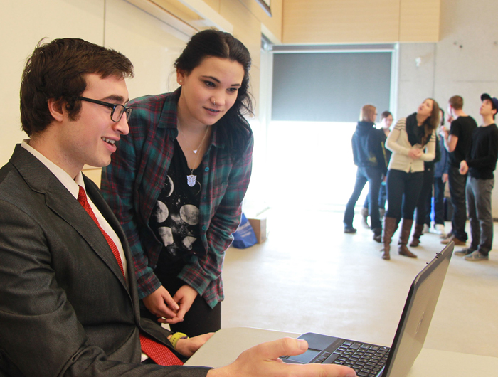 Mason Ainsworth, a third year Business student at Lakehead Orillia demonstrates the new Co-curricular Record to fellow student, Susanne Lauro, a third year student in the Honours Bachelor of Arts and Science program.
