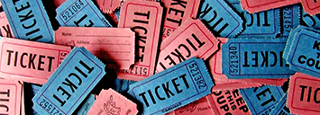 Red and blue coloured tickets are pictured in a pile