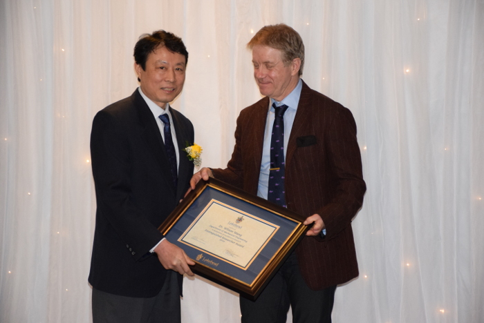 Dr. Andrew Dean, Lakehead's Vice-President, Research and Innovation, right, presented Dr. Wilson Wang with the Distinguished Researcher Award on Thursday.