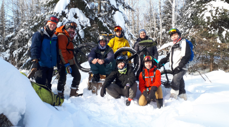 Group photos of students with a fat bike in the snow.