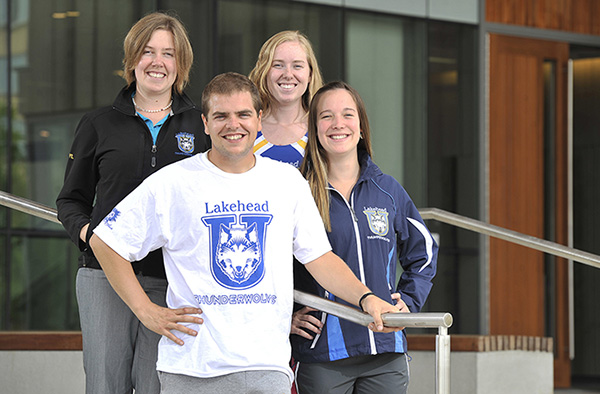 Lakehead Orillia Athletics and Recreation Facilitator (left) with athletes.