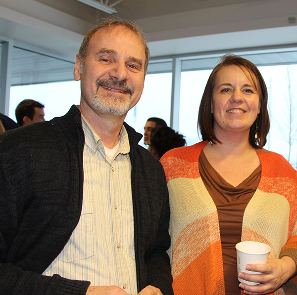 Civitas Award recipient Will McGarvey meets Lakehead graduate student Debbie Balika at Lakehead's Research & Innovation event