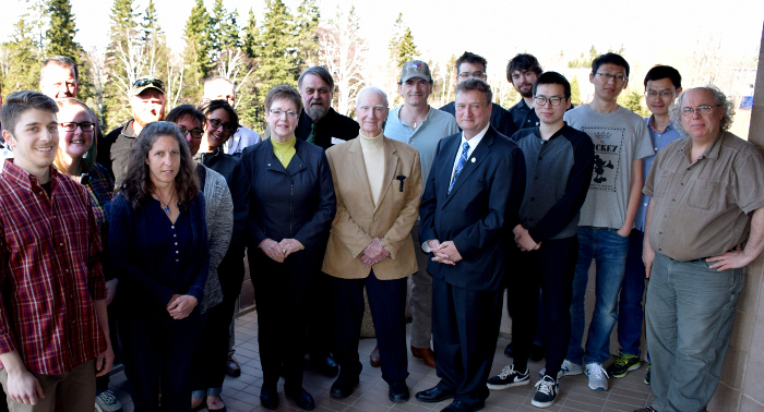 Photo of Dianne Miller with staff and students on the President's balcony.
