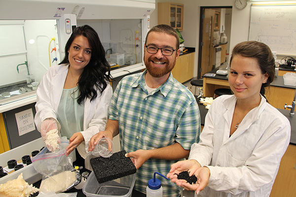 Lakehead students Brooke Marion (left) and Kayla Snyder spent the summer working with Lakehead's Dr. Chris Murray on a research project to develop a new environmentally friendly permeable pavement. The students' work was recently accepted for publication in an international scientific journal.