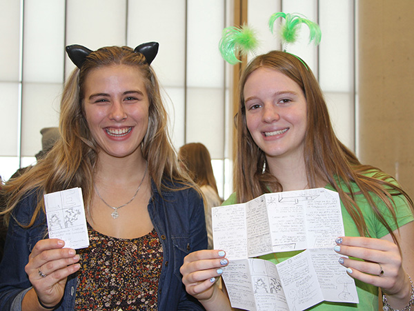 "Lakehead students Hailey Mulhall and Julie Puckering present a ""zine"" that was created (using one sheet of paper) to provide information about the University's environmental practices for a unique class project that resulted in a ""protestival."""