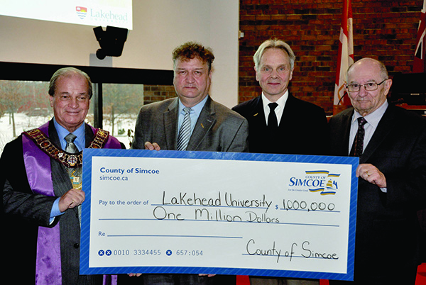 The County of Simcoe makes $1 million contribution to Lakehead University Orillia during County Council. Left to right: Warden Cal Patterson; Dr. Brian Stevenson, President and Vice-Chancellor, Lakehead University; Dr. Kim Fedderson, Dean and Vice Provost, Orillia Campus; and Mr. Bruce Waite, Member of the Lakehead University Board of Governors.