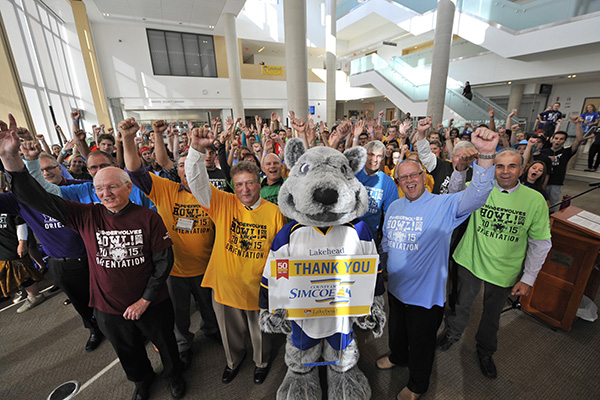 "County of Simcoe Warden Gerry Marshall, Lakehead University President & Vice-Chancellor Dr. Brian Stevenson and members of County Council join Lakehead mascot ""Wolfie"" and new students to kick-off Orientation activities with the traditional ""Thunderwolves Howl"" cheer."