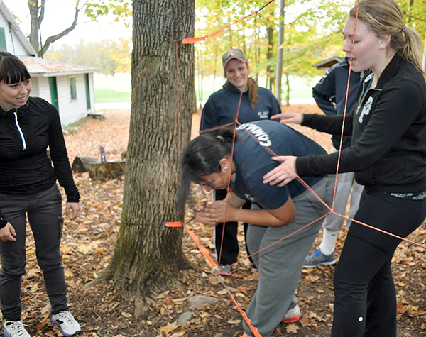 "The ""spider web challenge"" taught students how to work together as a team to accomplish a task."