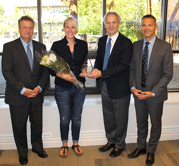 Photo: Lakehead student Whitney Page receives the 2016 Lloyd Dennis Award for outstanding citizenship from (l – r): Lakehead President & Vice-Chancellor Dr. Brian Stevenson, Lakehead Orillia Principal Kim Fedderson, and Lakehead University Board of Governors Chair, Murray Walberg.