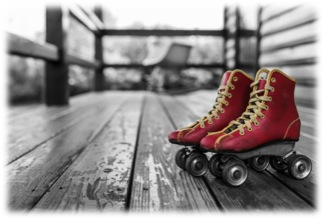 A pair of red leather roller skates with yellow trim and details in the foreground on the porch of a home the background is in black and white and grey tones