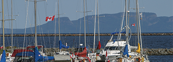 Thunder Bay's view of the Sleeping Giant from the marina with sail boats on the lake
