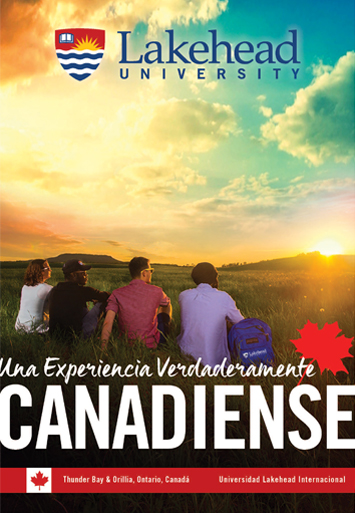 The cover of the 2017 Lakehead International Brochure in Spanish. It displays students sitting in a row during a beautiful sunset in a park