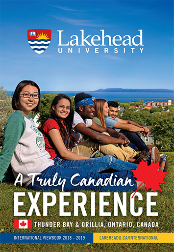 The cover of the 2017 Lakehead International Viewbook in English. It displays students sitting in a row during a clear day in a park