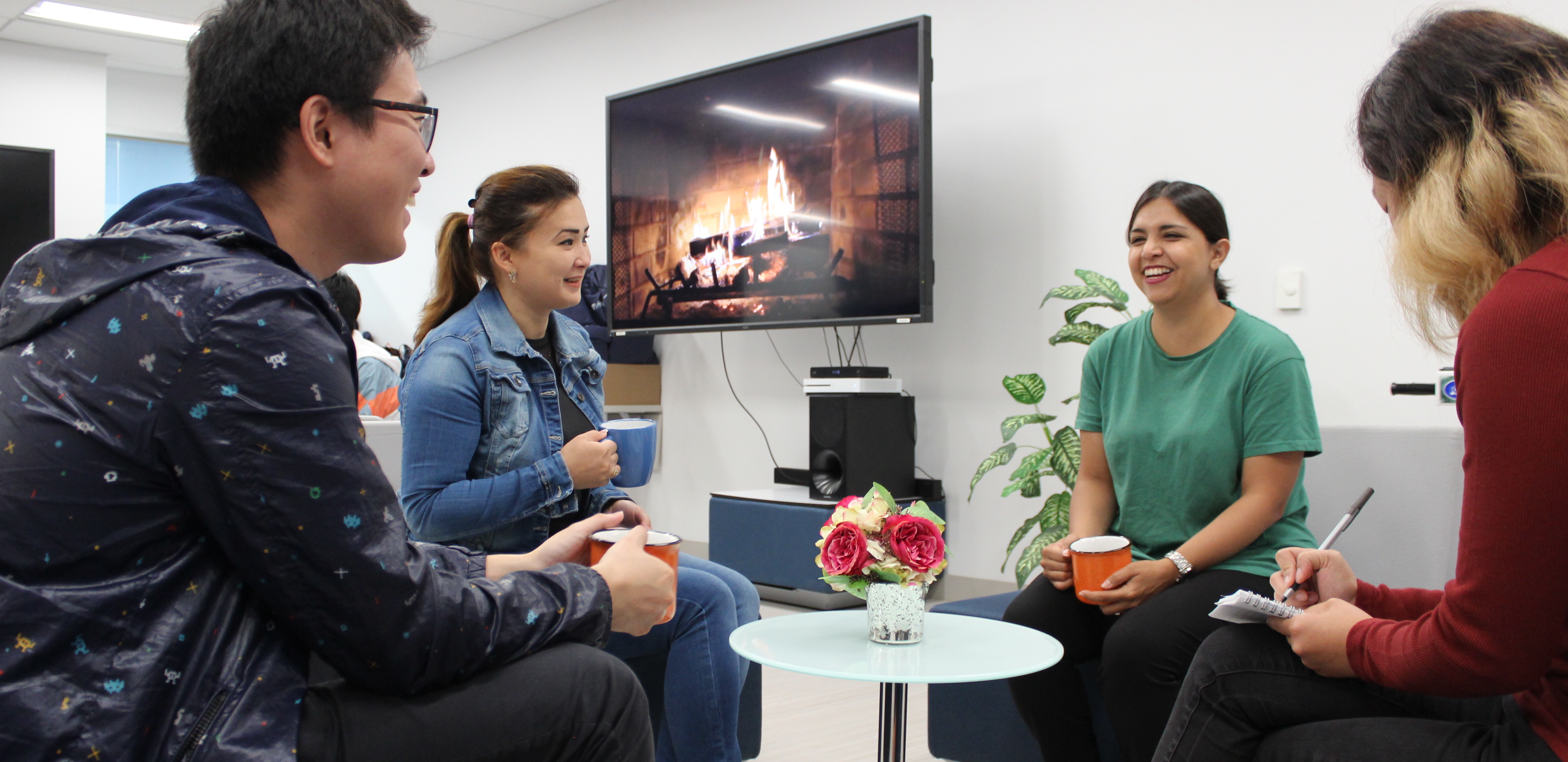 Students in the International Student Lounge participating in a conversation club session