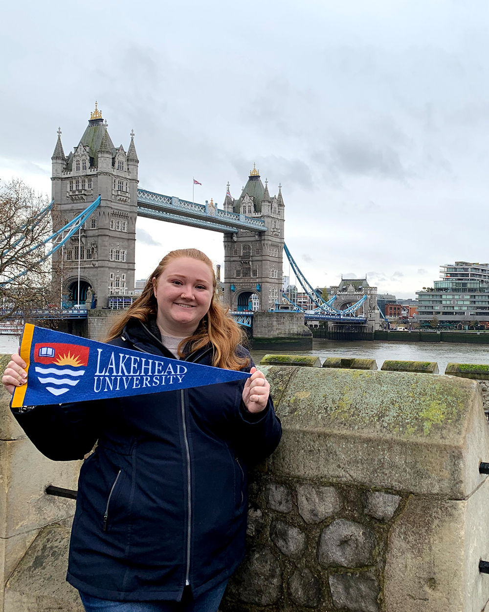 Student standing in front of Tower Bridge in London, England