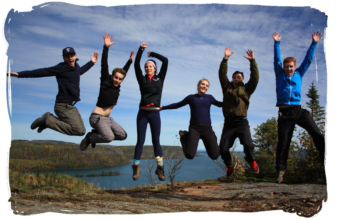 Students jumping on a hilltop